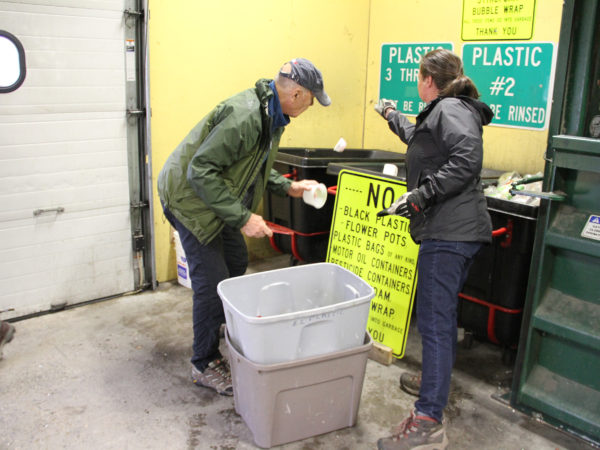 Jennifer Reid helping visitor to the recycling center in North Elba