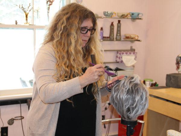 Lizzie Boolukos inside her salon in Cumberland Head