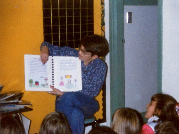 Teacher Judy Keeler reading to students in Alexandria Bay