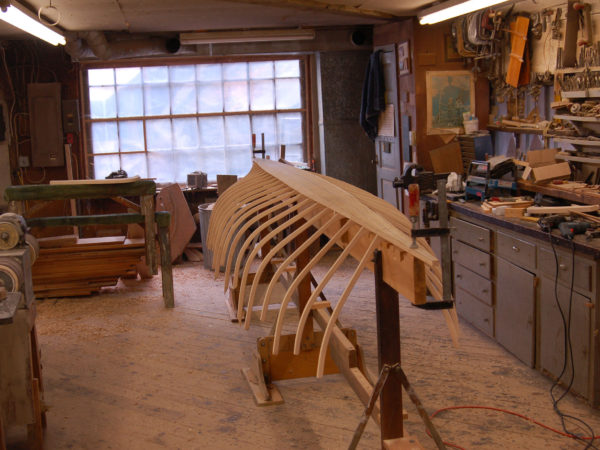 Partially constructed guideboat in the Woodward Boat Shop in Saranac Lake