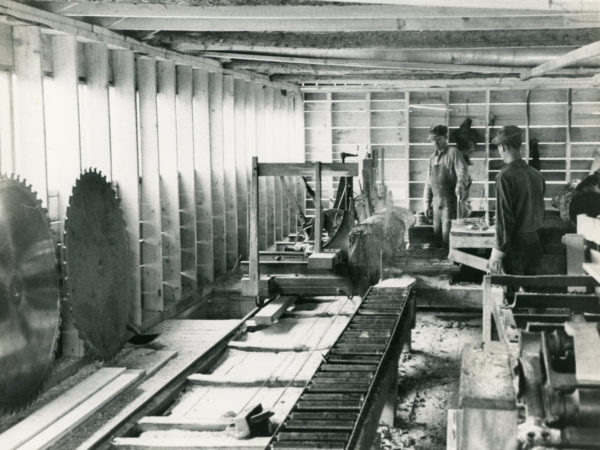 Workers inside the Triangle Lumber Company mill in Onchiota
