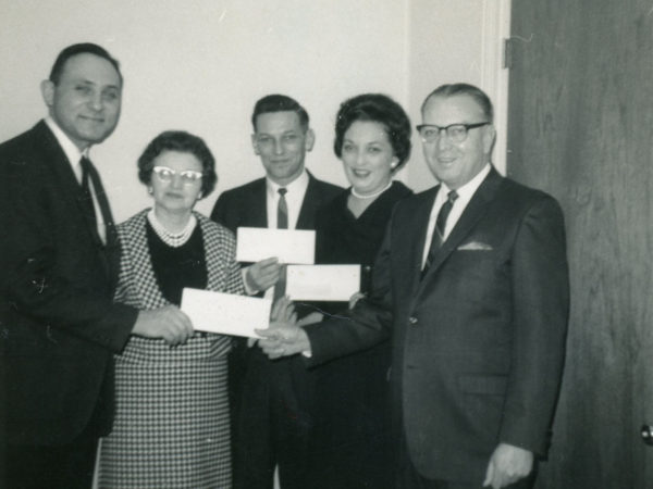 Patrick John Henry McKenty receiving an award at the Saranac Lake Savings and Loan