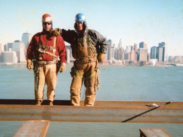 Mohawk ironworkers on a beam overlooking NYC
