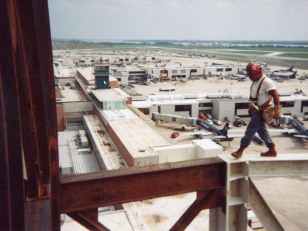 Darryl Lazore walking a 600 ft high beam