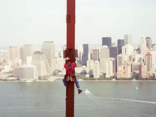 Akwesasne's Darryl Lazore climbing an iron beam