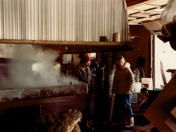 Eleanor and Allen Warren watch the evaporator in the Allen sugarhouse in Croghan