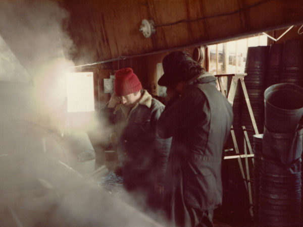 Warren Allen and Steve Zehr boil maple sap into syrup at the Allen sugarhouse.