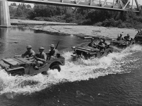 4th Armored Division crossing the Black River in jeeps at Pine Camp