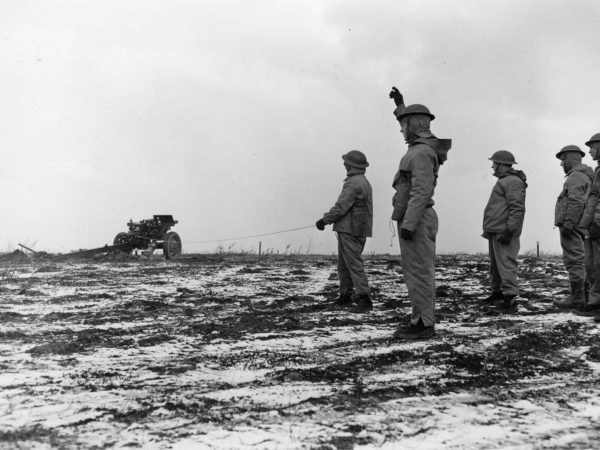 Soldiers from the 4th Armored Division firing off a cannon at Pine Camp