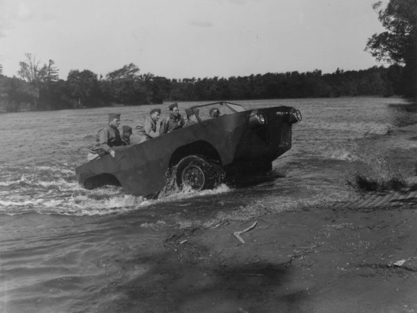 Amphibious vehicle emerging from the water at Pine Camp