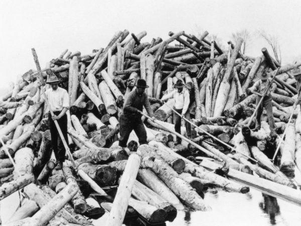 Rivermen working the Big Boom on the Hudson River near Glens Falls