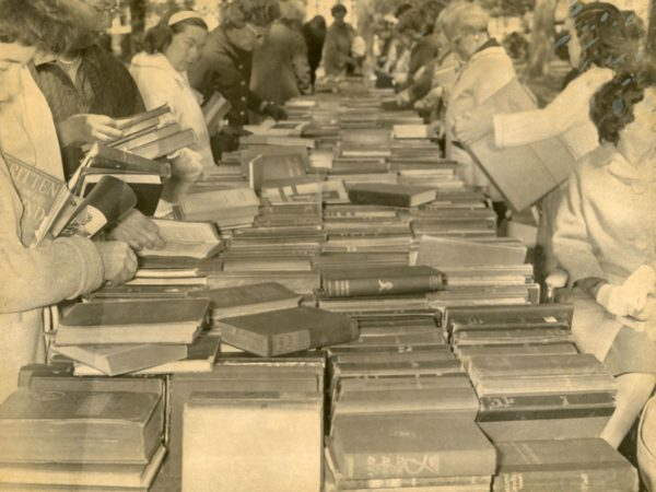 People peruse books at the Friends of Crandall Library book sale in Glens Falls