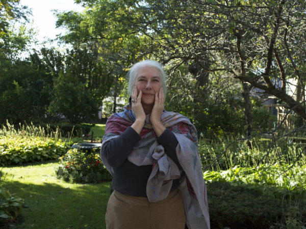 Delia Windwalker practicing healing touch in Watertown