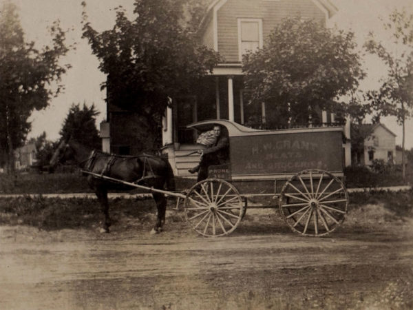 H. W. Grant grocery wagon on Cooper Street in Watertown