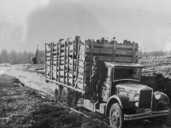Harold Champney hauling timber for Carl Tracy's trucking company in Colton