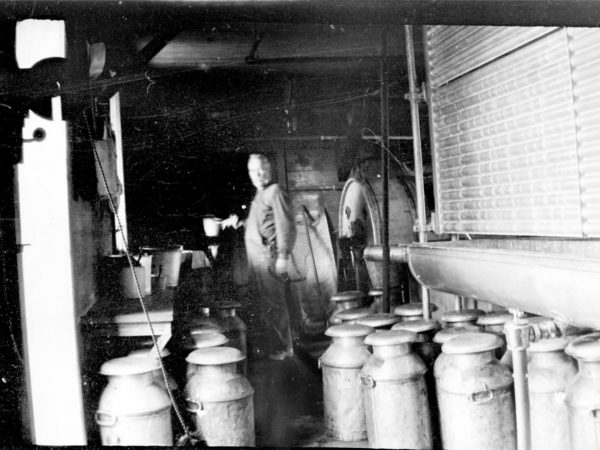 John Duncan Currie in his creamery at Aubrey Corners