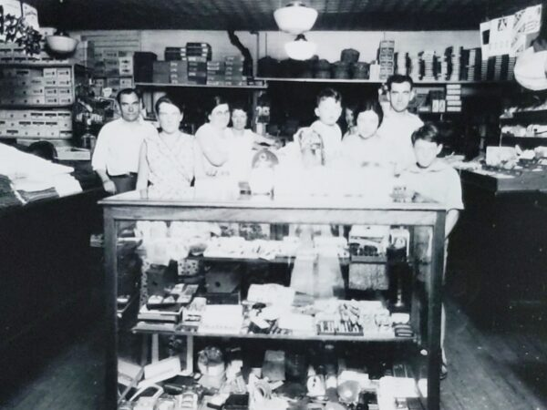 Photo of the Saidel family inside their general store at the corner of Lakeside Drive and Horicon Avenue in Bolton Landing