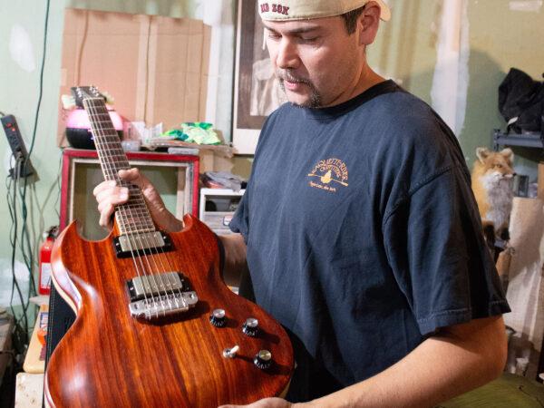 Glenn Hill holds guitar