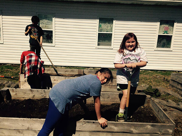 Students working on garden bed