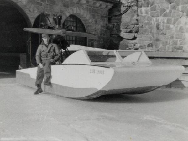 Gerald Heath sits on iceboat