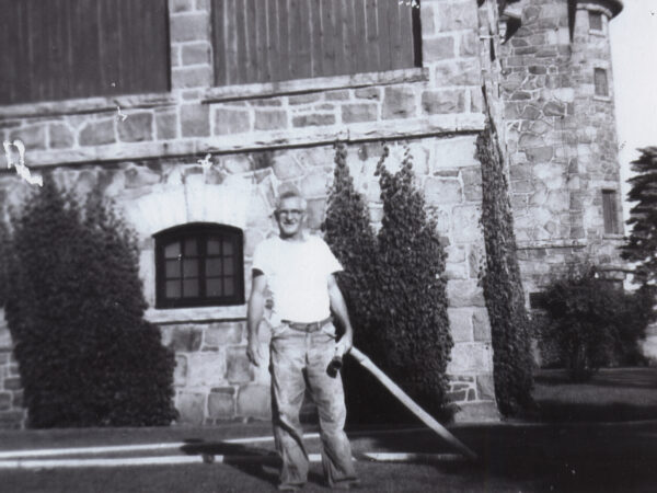 Gerald Heath holds hose